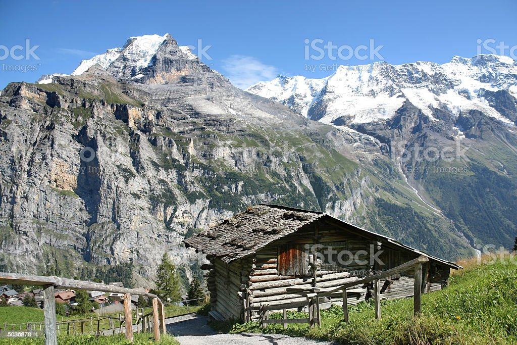 wooden hut at Swiss Alps stock photo
