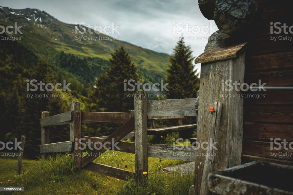 Wooden hut in the Swiss Alps stock photo