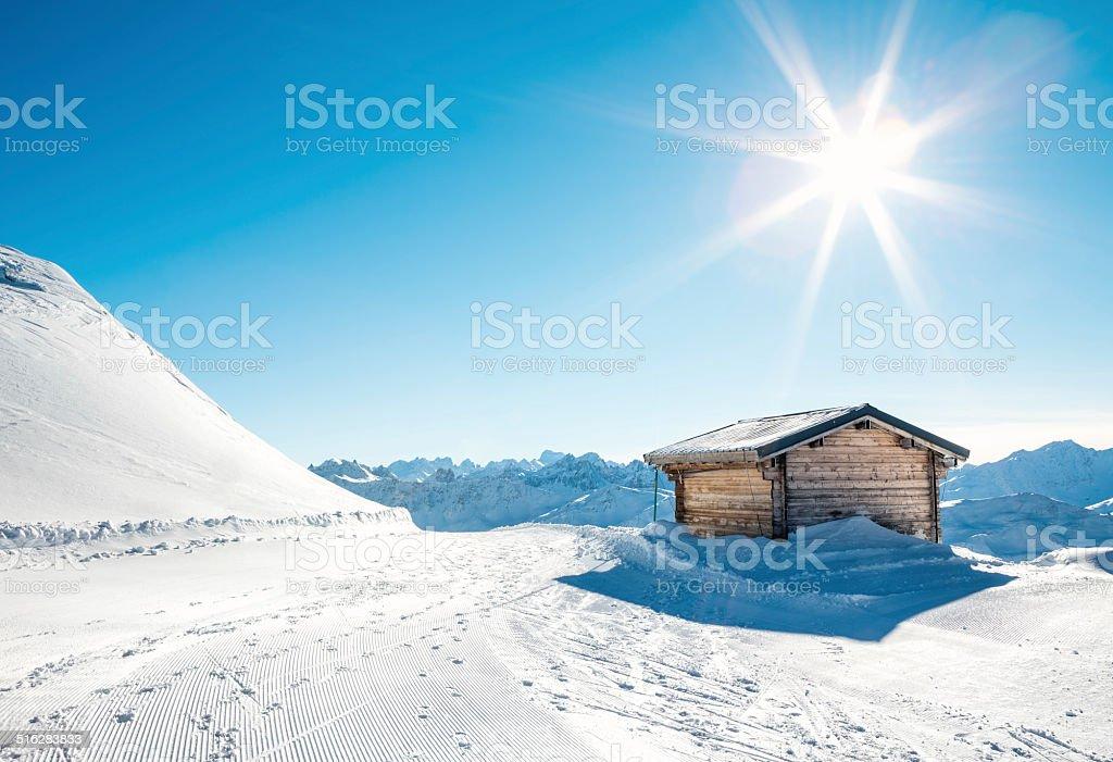 Wooden Hut On Ski Slope stock photo