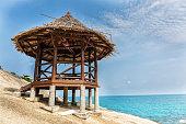 Wooden hut on a rocky beach