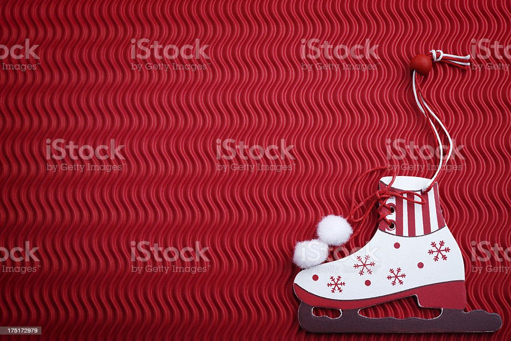 Wooden ice skate on red background royalty-free stock photo