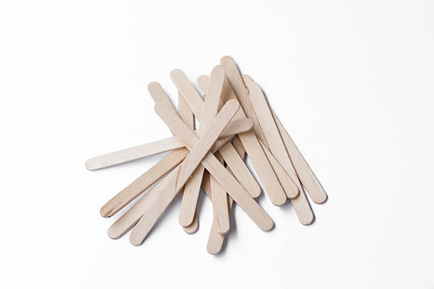 Wooden ice-cream sticks on white background Wooden ice-cream sticks on white background stick plant part stock pictures, royalty-free photos & images