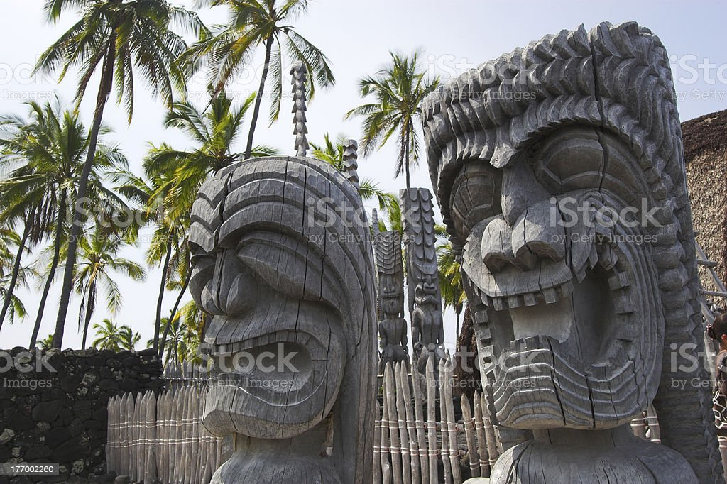 Wooden idols and temple stock photo