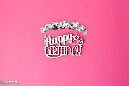 istock Wooden inscription happy birthday on a pink background. 1094563208
