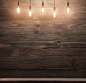 wooden interior room with classic Edison light bulb