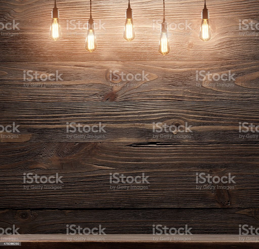wooden interior room with classic Edison light bulb stock photo