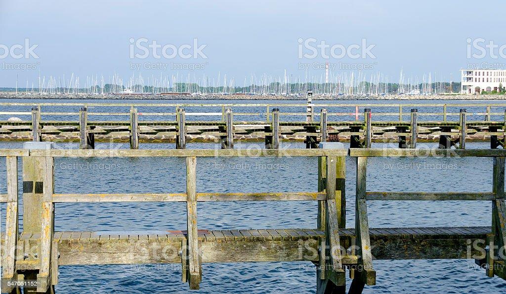 wooden jetties in the harbour of Warnemuende stock photo