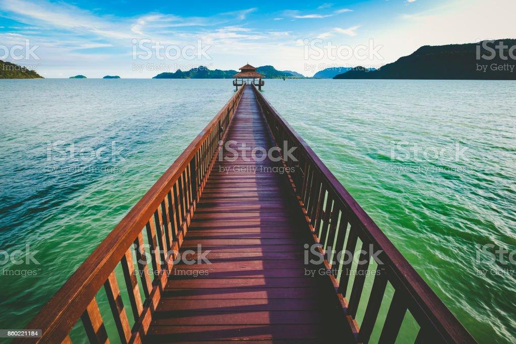 wooden jetty, andaman sea, langkawi island, malaysia stock photo