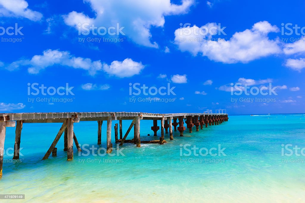 Wooden jetty going out to ocean stock photo