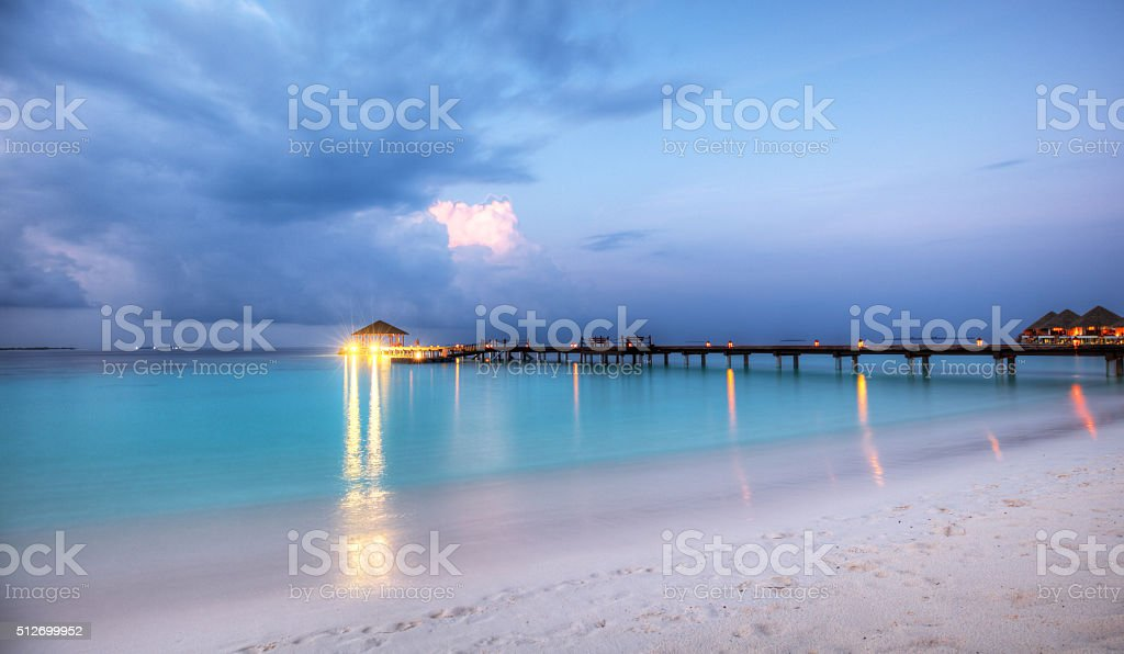 Wooden jetty in sunset stock photo