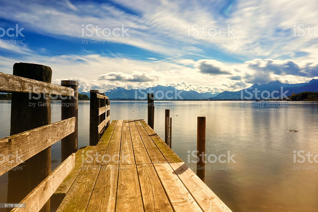 wooden jetty lake chiemsee stock photo