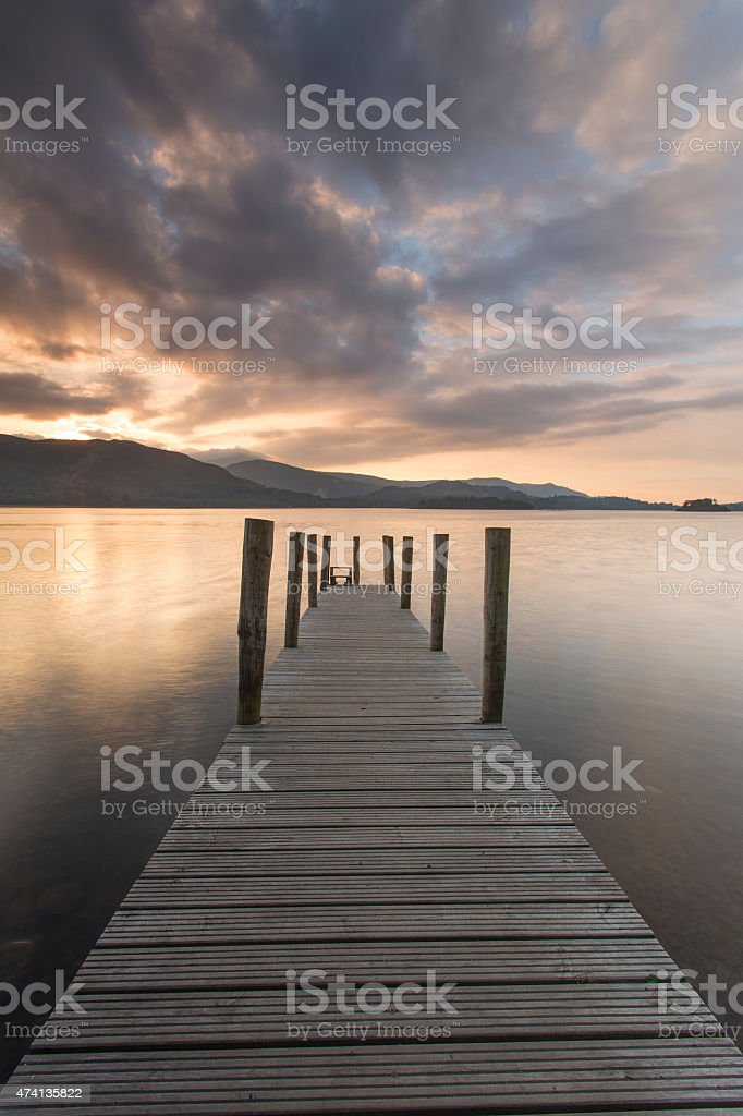 Wooden jetty on Derwent water, looking  west towards Catbells mo stock photo