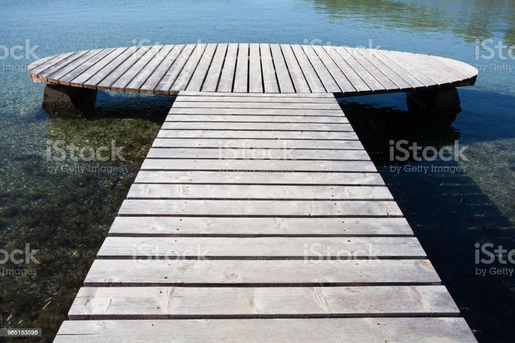 wooden jetty with round end royalty-free stock photo
