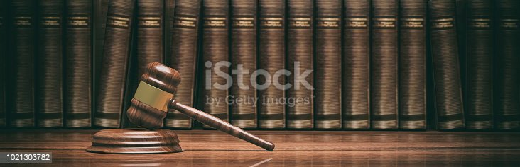 istock Wooden judge gavel and books. 3d illustration 1021303782