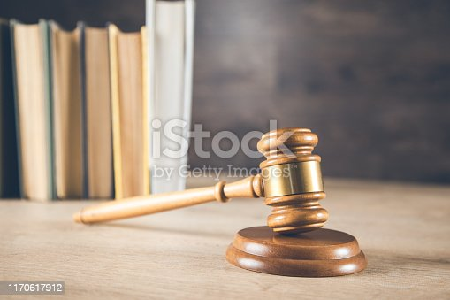 wooden judge with books on the wooden table background