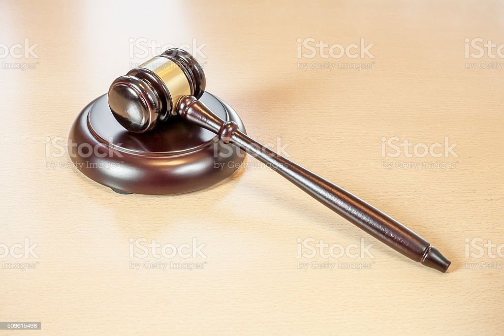 Wooden judges gavel on table stock photo
