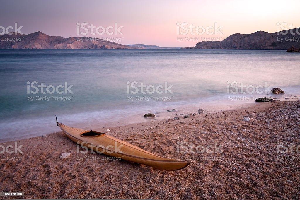 Wooden kayak stock photo