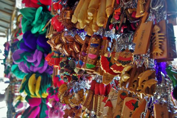 wooden key chain souvenir items - baguio city stock photos and pictures
