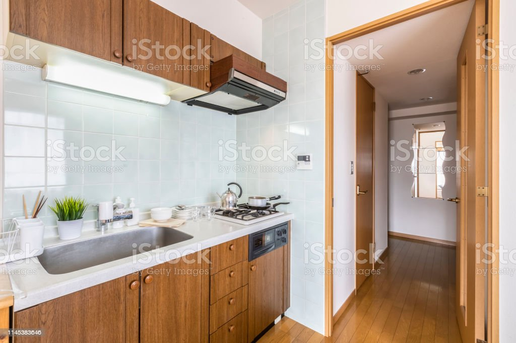Wooden kitchen counter in small apartment