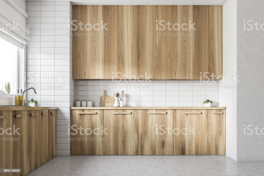 Wooden kitchen countertops under window side view zbiór zdjęć royalty-free