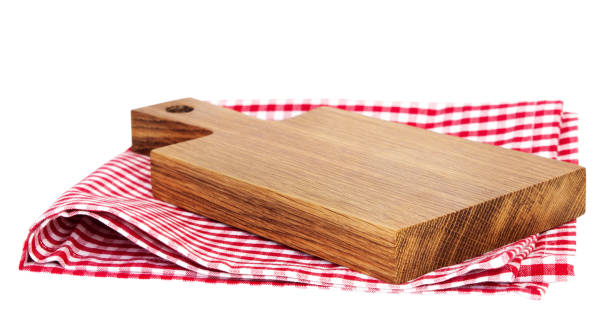 wooden kitchen empty board on red picnic cloth isolated. - разделочная доска стоковые фото и изображения