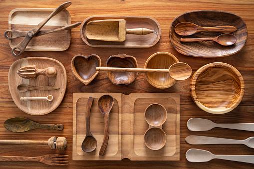 Wooden kitchen utensils cuttlery on wood background