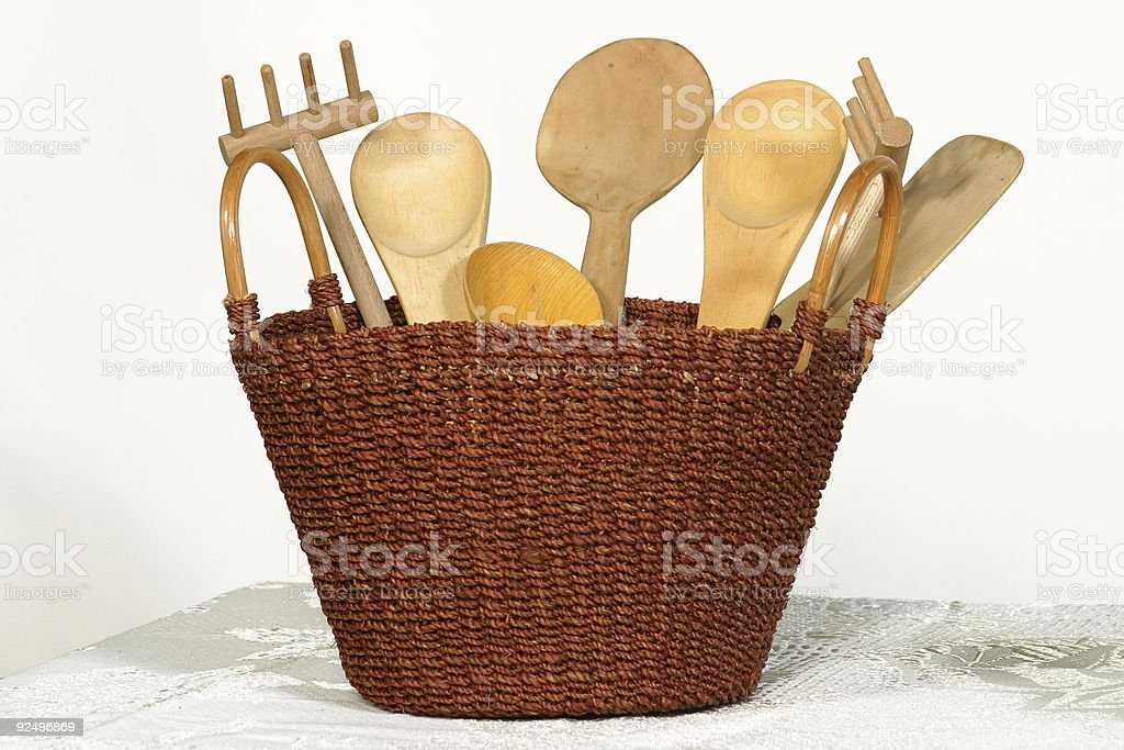 wooden kitchen utensils in woven basket royalty-free stock photo