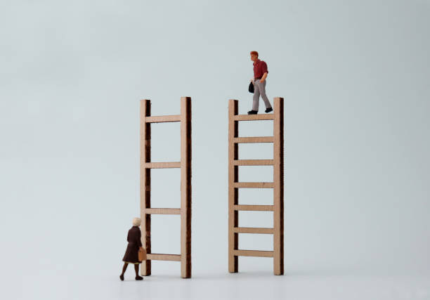 Wooden ladders and miniature people. The concept of difficulty in promoting women to work. Wooden ladders and miniature people. The concept of difficulty in promoting women to work. discriminatory stock pictures, royalty-free photos & images
