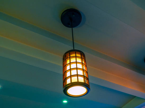 Wooden lamp hanging from plaster ceiling Wooden lamp hanging from plaster ceiling plaster ceiling design stock pictures, royalty-free photos & images