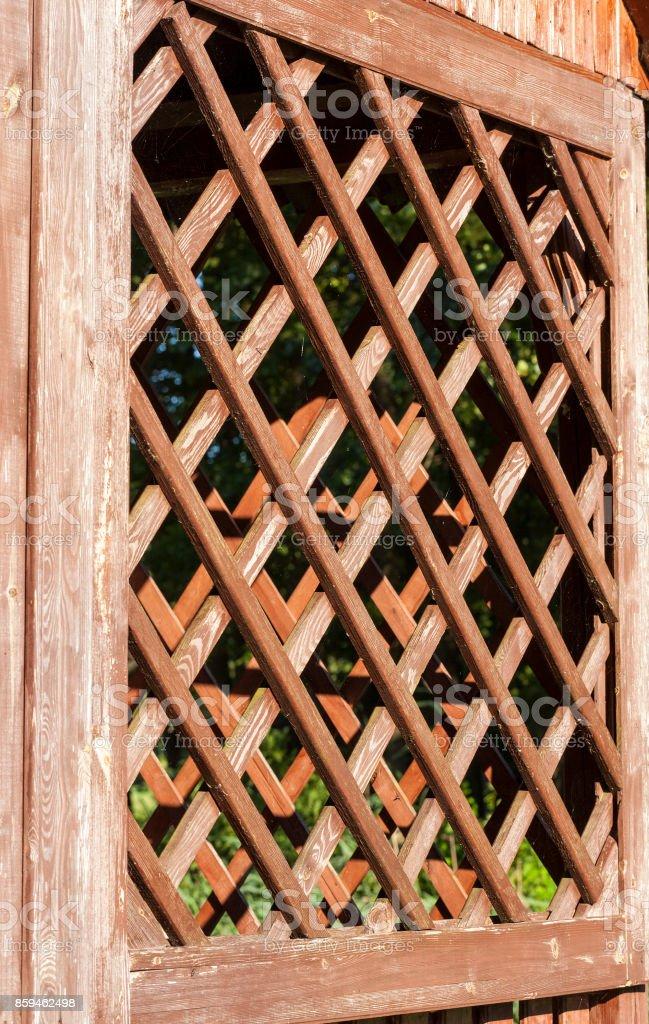 wooden lattice arbor stock photo