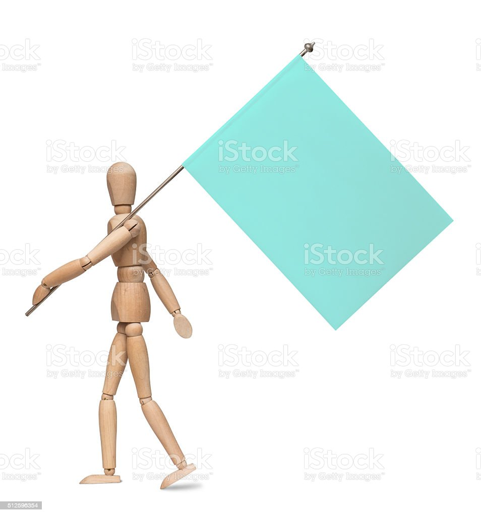 Wooden lay figure marches with a flag on iron spike. stock photo