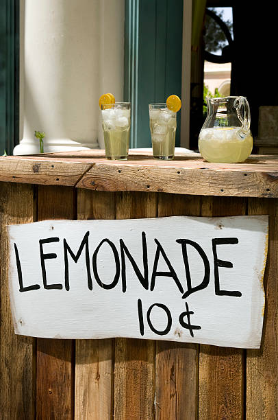 A wooden lemonade stand with two glasses and a jug Lemonade Stand with Pitcher and Glasses lemonade stand stock pictures, royalty-free photos & images
