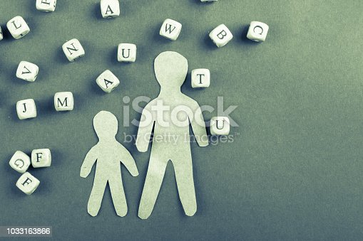 istock Wooden letter cubes   and men figurine 1033163866