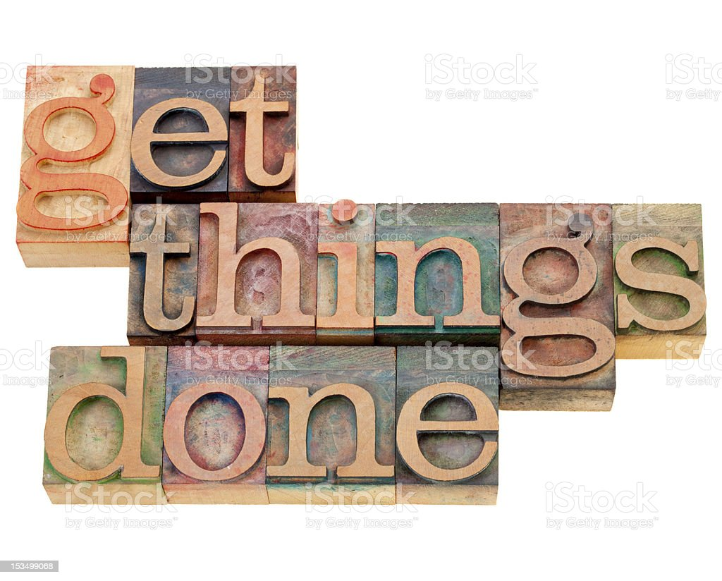 Wooden letter stamps arranged to make getting things done royalty-free stock photo