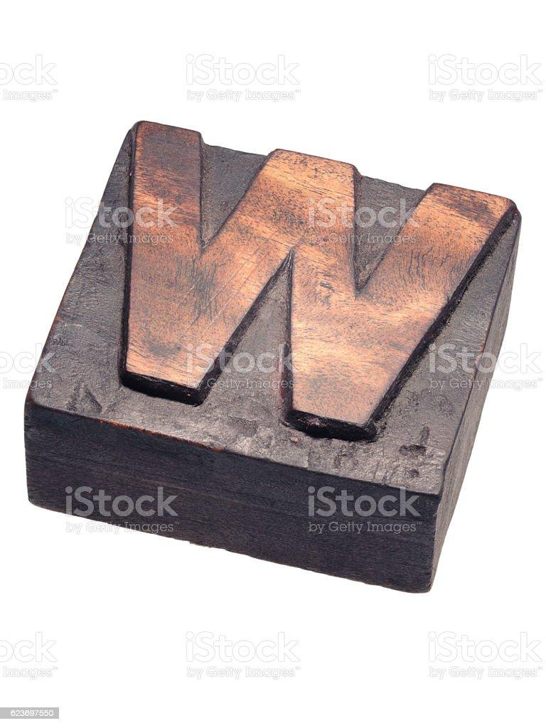 wooden letterpress W block stock photo