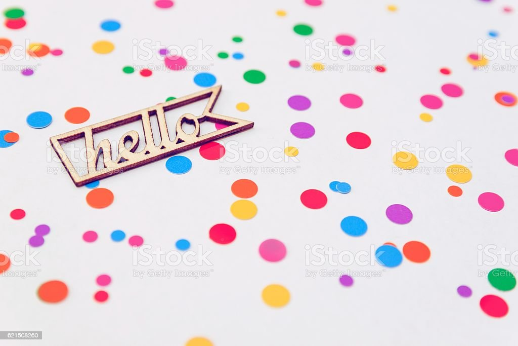 wooden letters Hello with colorful confetti on white background foto stock royalty-free
