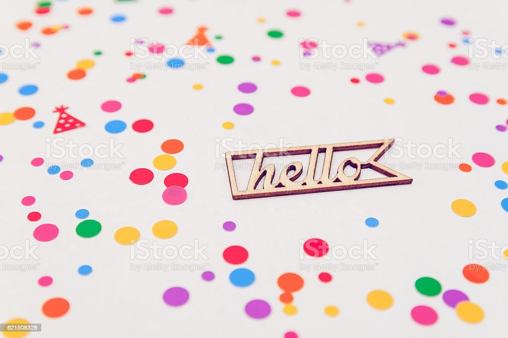 wooden letters Hello with colorful confetti on white background Lizenzfreies stock-foto
