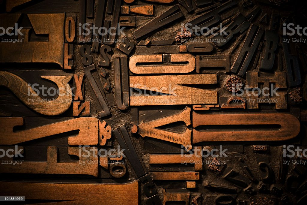 Wooden letters on a dark brown background royalty-free stock photo