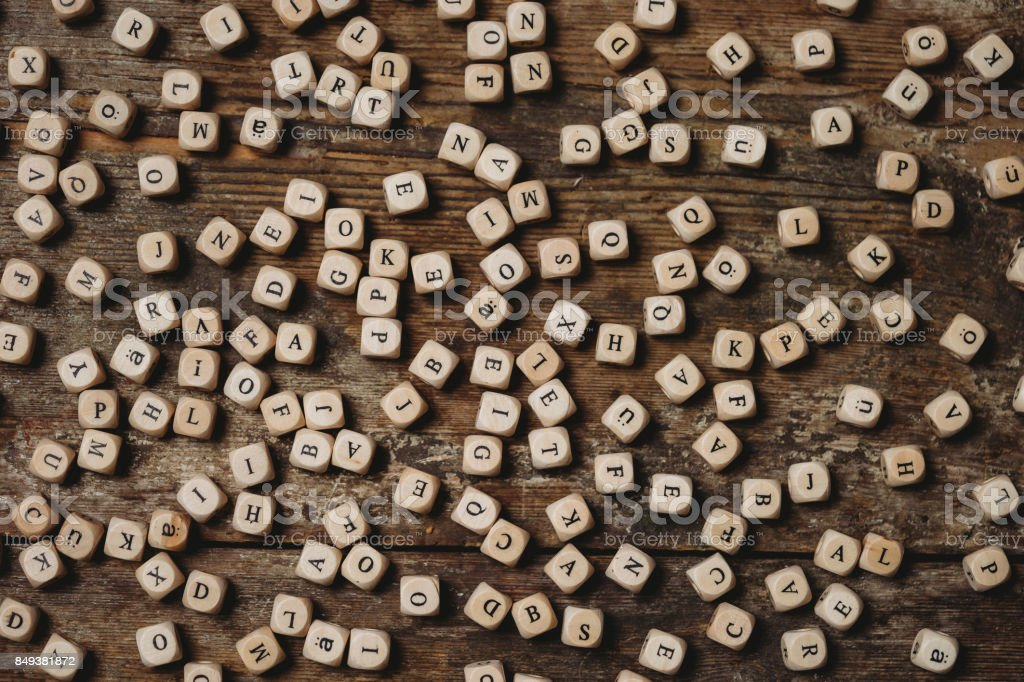 Wooden letters on a table stock photo