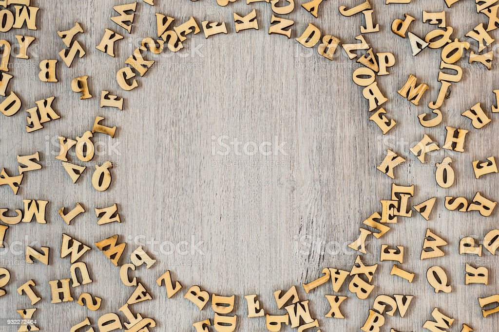 Wooden letters on the table, alphabet, space for text stock photo