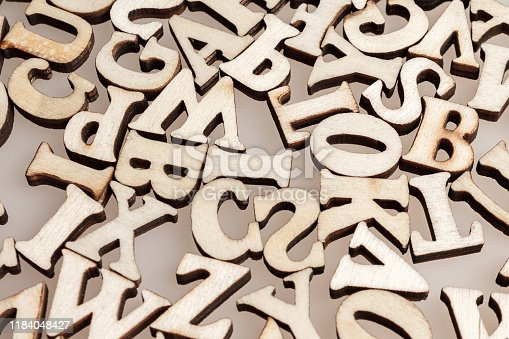 wooden letters of the English alphabet workpiece closeup macro
