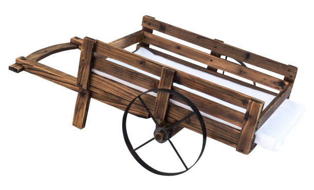 wooden little wheelbarrow on two wheels isolated wooden little wheelbarrow on two wheels isolated on white background pitchfork agricultural equipment stock pictures, royalty-free photos & images