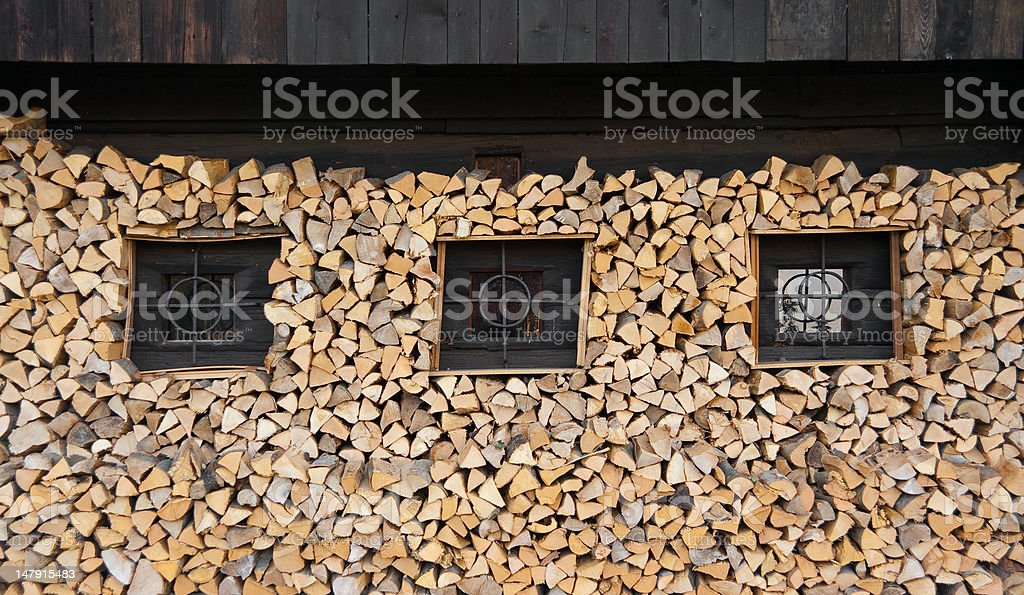 Wooden Log Farm House With Firewood royalty-free stock photo