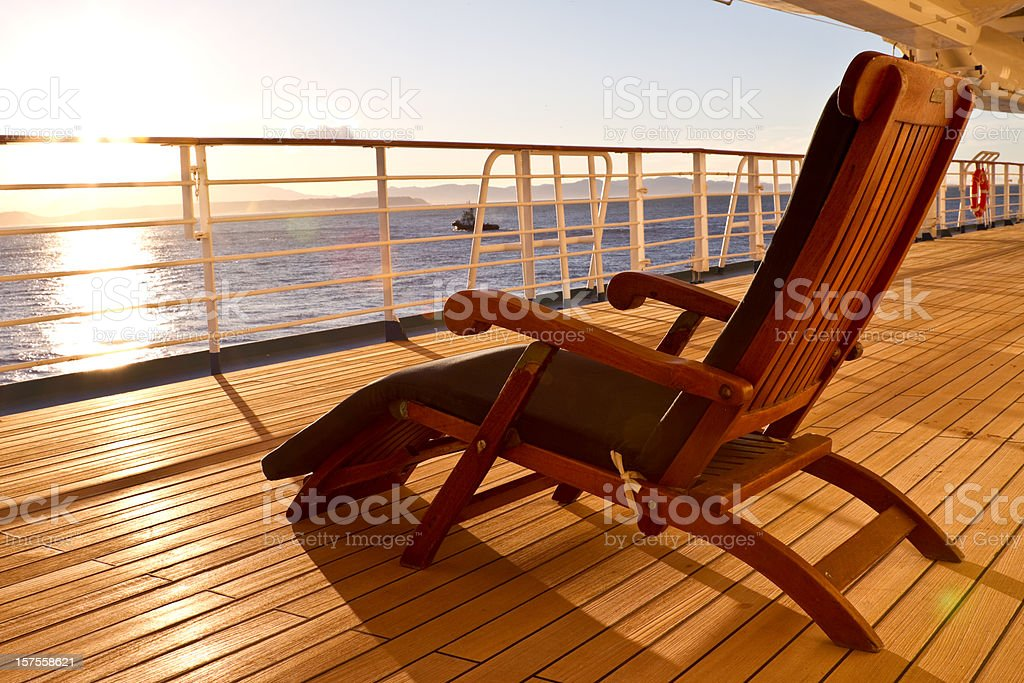 Wooden lounge chair on the deck of a cruise ship stock photo