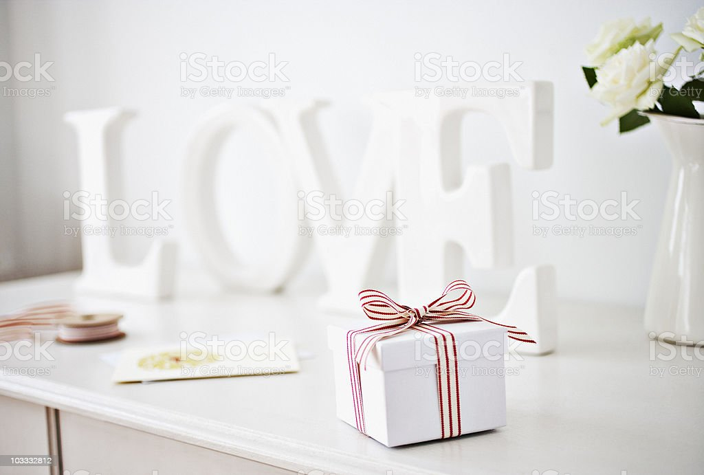 Wooden 'love' letters decoration and gift box with ribbon on desk stock photo