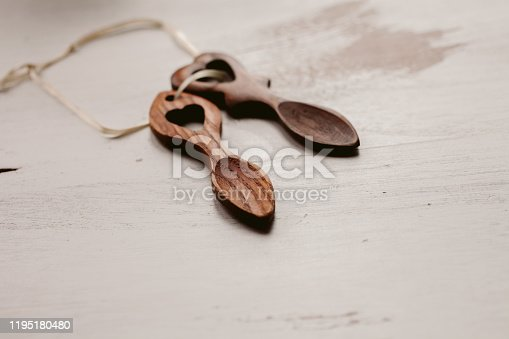 Wooden love spoons from Wales. Traditional welsh wooden spoons on white background. Handcrafts.