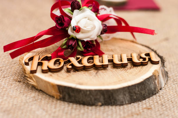 Wooden love word with ladybug for wedding stock photo