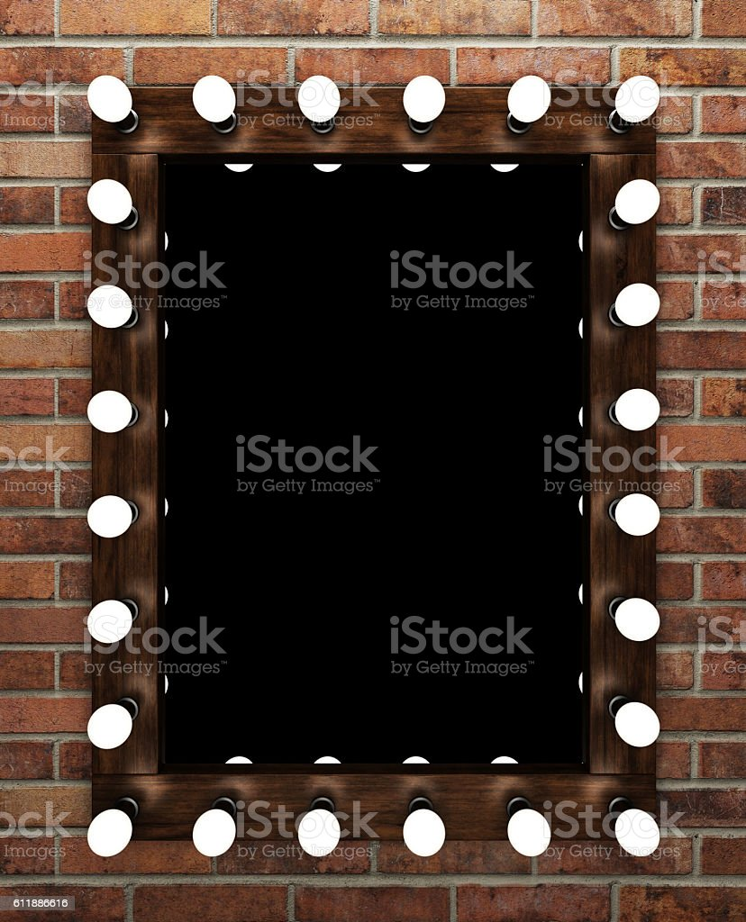 Wooden makeup mirror on brick wall stock photo