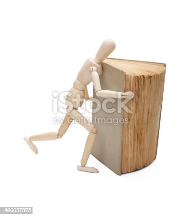 153178960istockphoto Wooden man and book 466037375