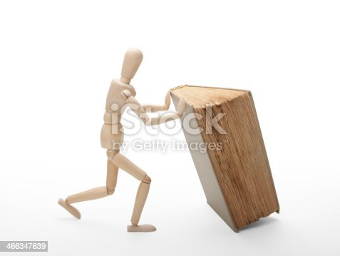 153178960istockphoto Wooden man and book 466347639